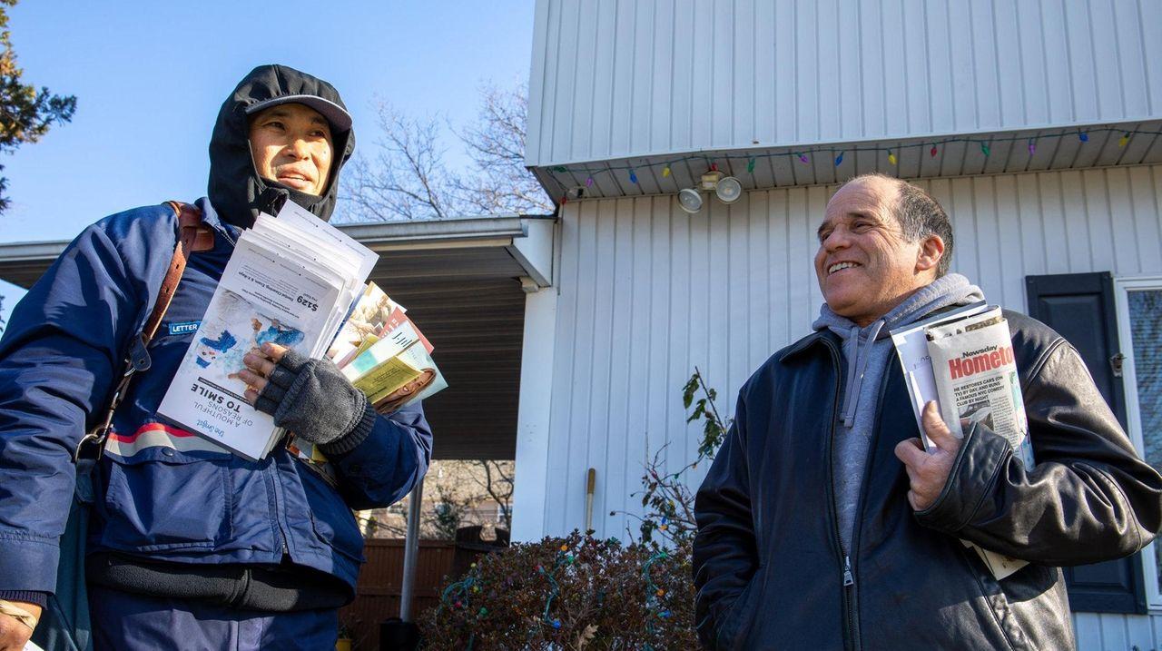 USPS letter carrier Jong Kwon, left, delivers mail