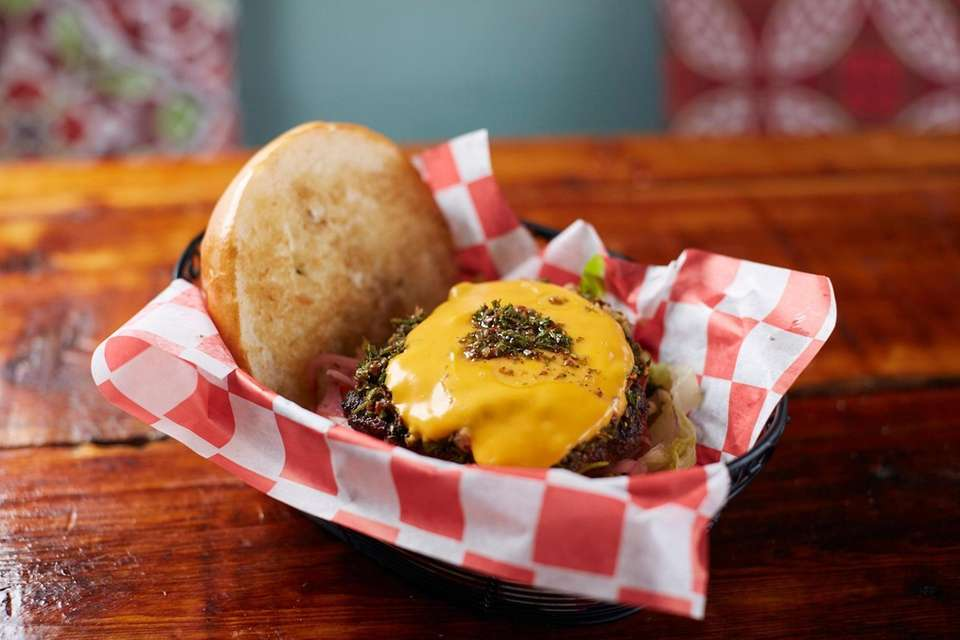 Queso smothers the Chori burger, a blend of