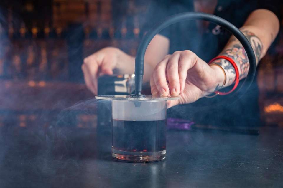 The Smoking Gun Cocktail served with a cover