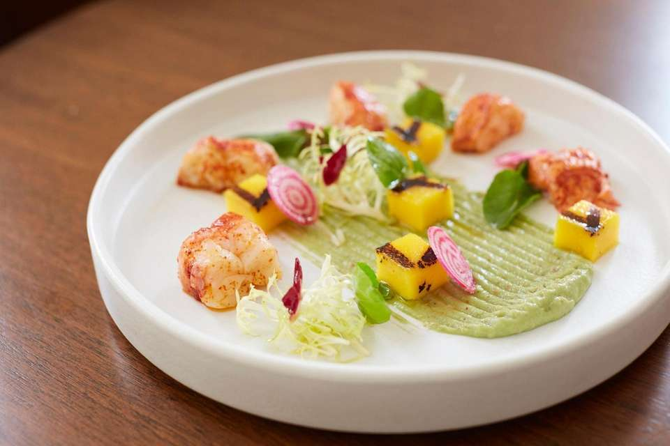 A starter of lobster meat with grilled mango,
