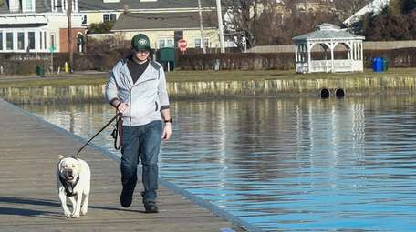 Greg McIlwee, of Patchogue, goes for a walk