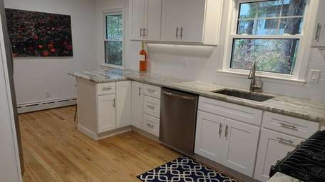 The kitchen and all three bathrooms are new