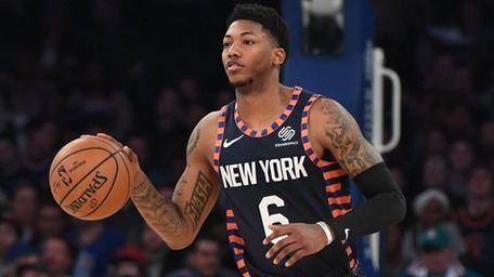 Knicks guard Elfrid Payton dribbles the ball upcourt