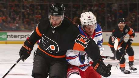 Kevin Hayes of the Flyers battles for the