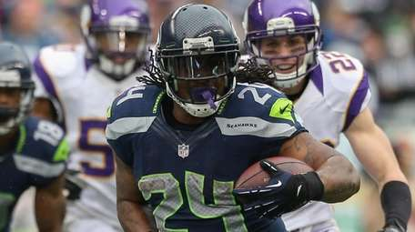 Seahawks running back Marshawn Lynch rushes against the