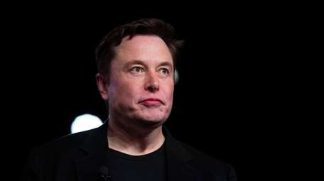 Tesla CEO Elon Musk pauses while speaking before