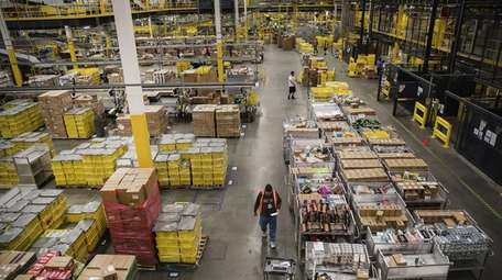 Employees fill online orders at the Amazon.com fulfillment