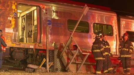 Emergency crews work on a LIRR derailment near