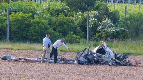 Brian Rayner, right, Air-Safety investigator with NTSB investigates