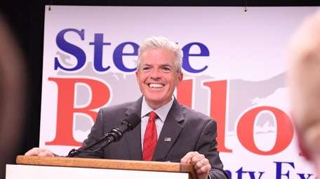 Suffolk County Executive Steve Bellone walks in to