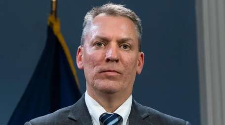 NYPD Chief of Detectives Dermot Shea listens during