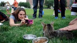 Kristin Backman of Minneapolis photographs Lil Bub before