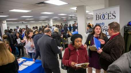 Applicants at a November job fair at Joseph