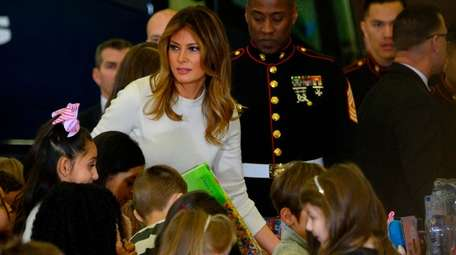 First lady Melania Trump gives out toys on