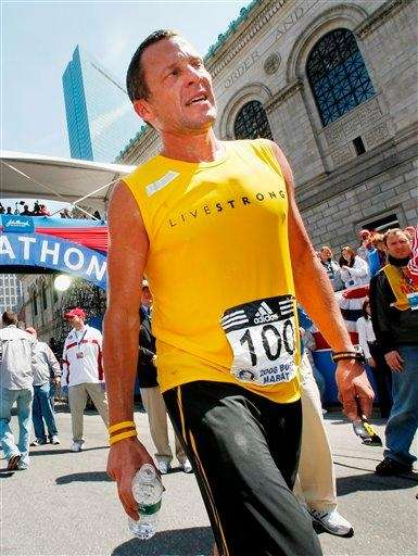 Lance Armstrong cools off after finishing the Boston