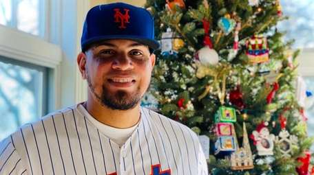 Mets reliever Dellin Betances poses in front of