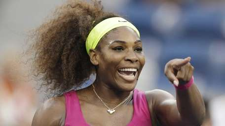 Serena Williams points to someone in the crowd