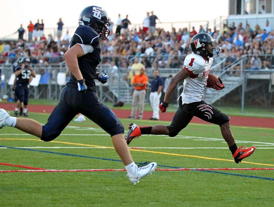 Newfield running back Terrell Perryman takes the ball