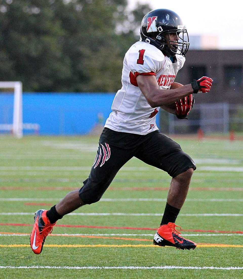 Newfield running back Terrell Perryman, takes the hand-off