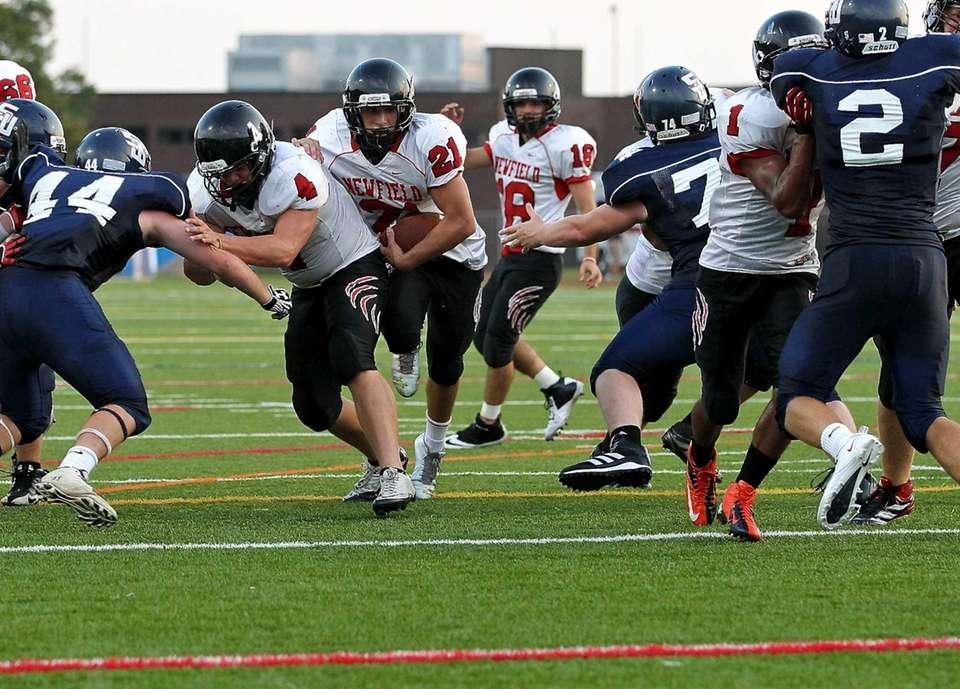 Newfield running back Joe Feliciano, takes the hand-off,