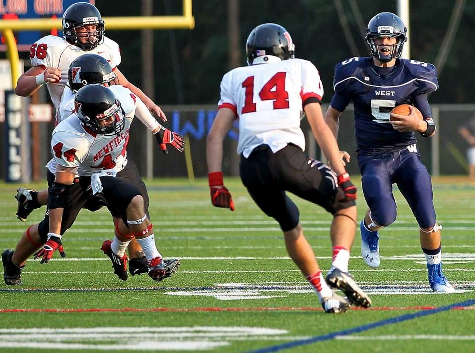 Smithtown West quarterback Matt Heldberg moves the ball