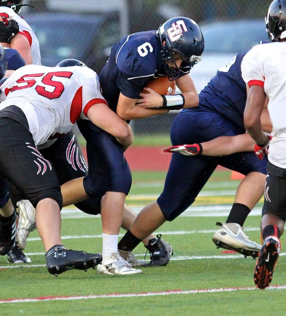 Smithtown West quarterback Ryan Keenan, moves the ball