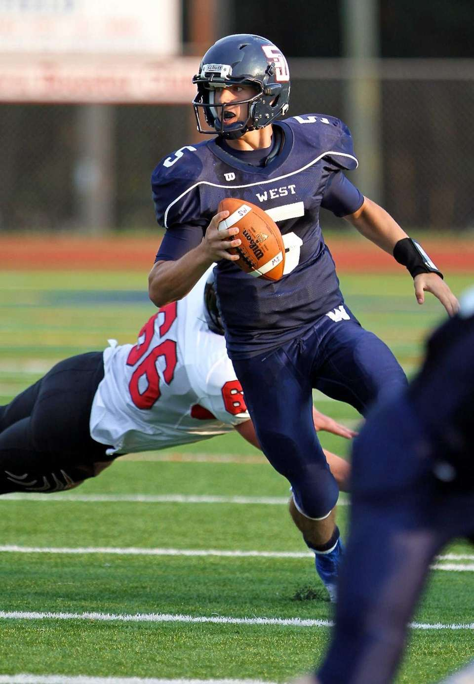 Smithtown West quarterback Matt Heldberg Jr. scrambles out