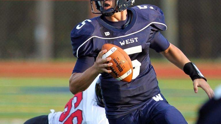 Smithtown West quarterback Matt Heldberg Jr. scrambles out