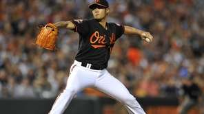 Baltimore Orioles pitcher Wei-Yin Chen throws to a