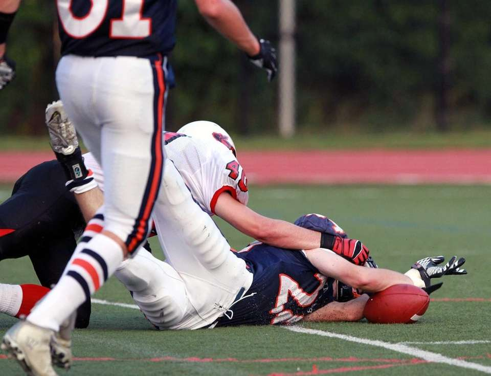 The ball gets away from Manhasset's Dylan Meyer