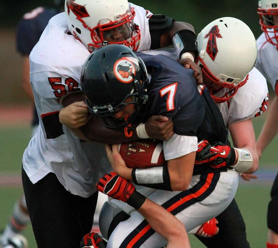 Manhasset quarterback Kevin Overlander can't get away from