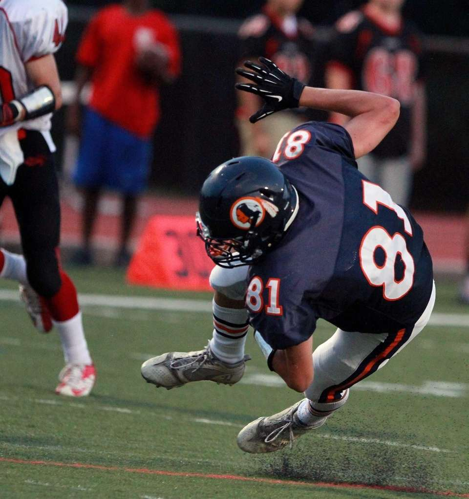 Manhasset's Jon Stefan gets tripped up just outside
