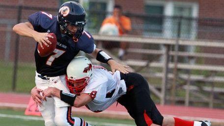 Floral Park's Connor Vidasolo sacks Manhasset quarterback Kevin
