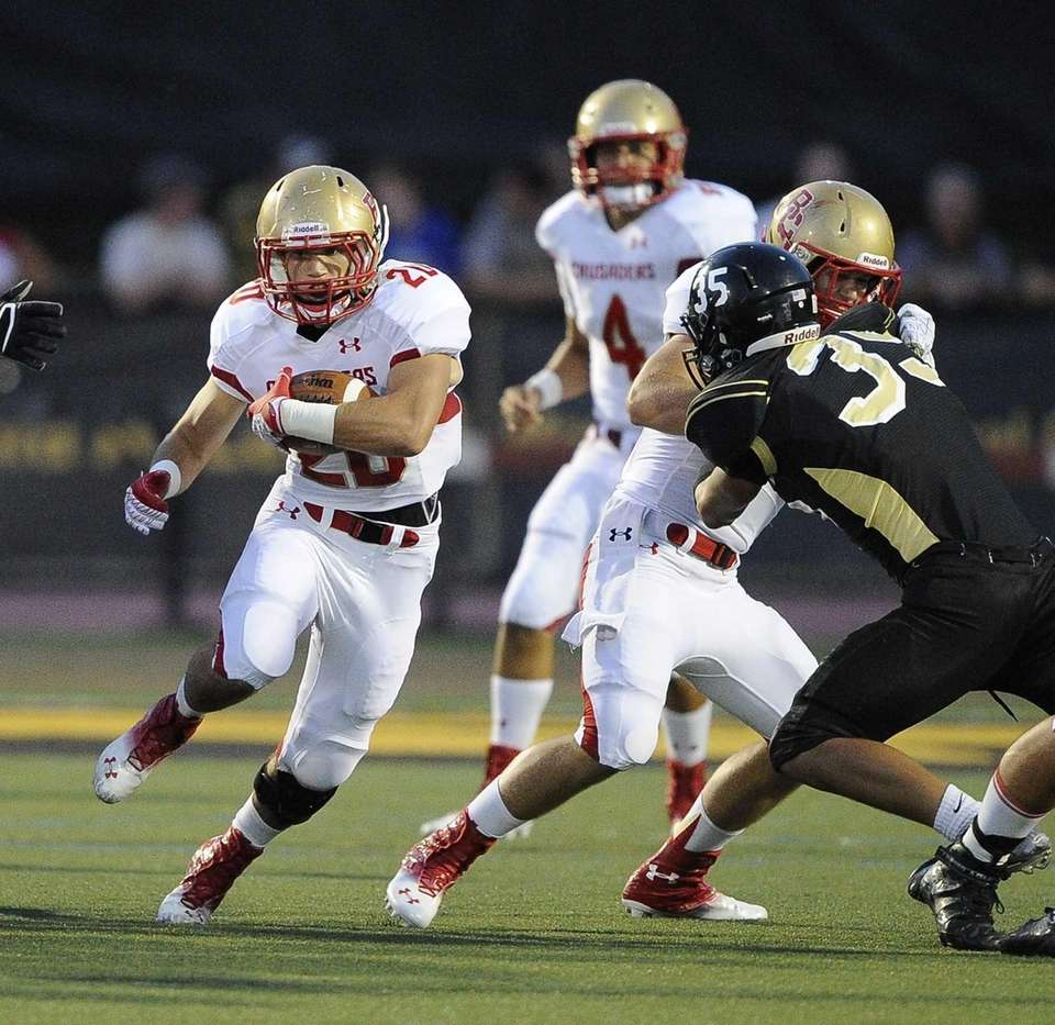 Bergen Catholic's James Dawson carries the ball in