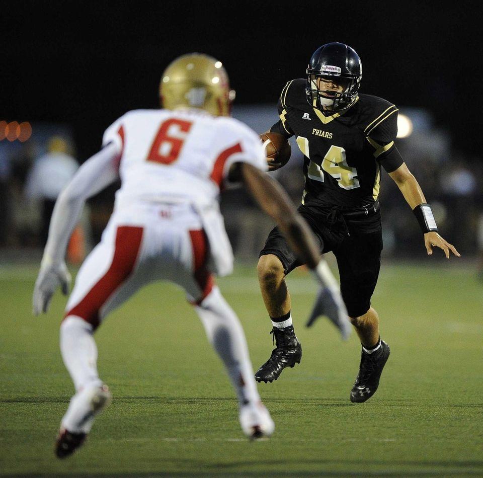 St. Anthony's quarterback Greg Galligan looks for open