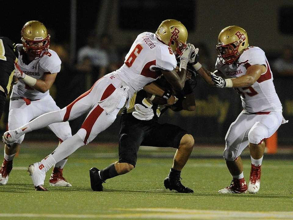 St. Anthony's quarterback Greg Galligan is sacked by