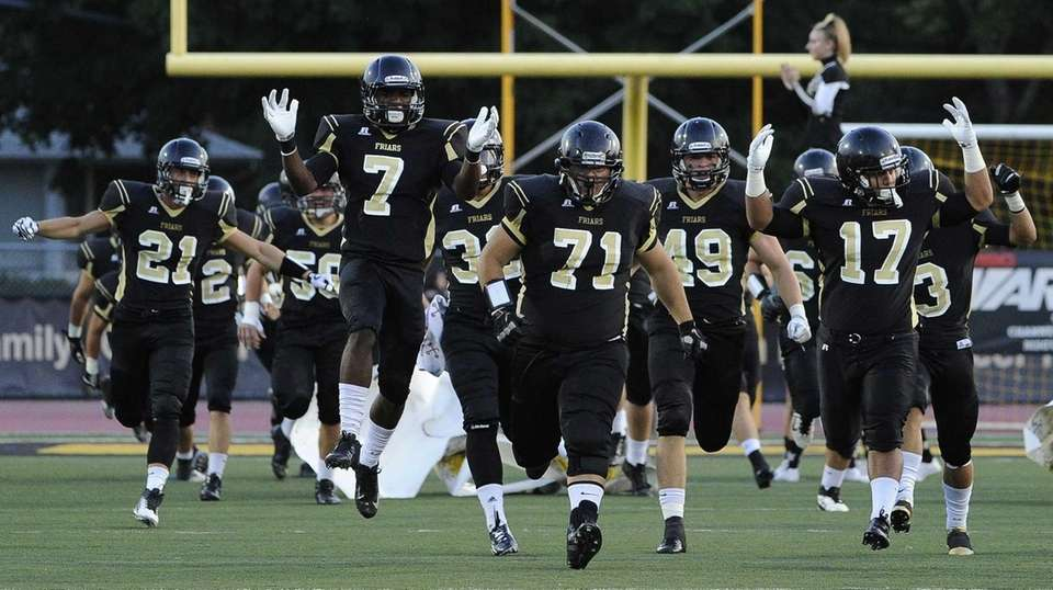 St. Anthony's football team takes the field before