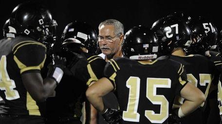 St. Anthony's head coach Rich Reichert talks to