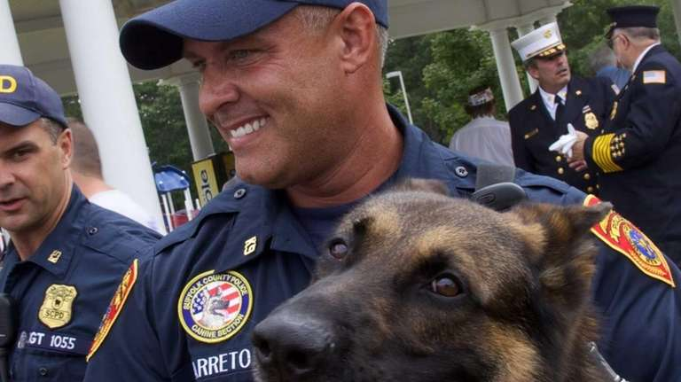 Suffolk County Police Officer Samuel Barreto with his