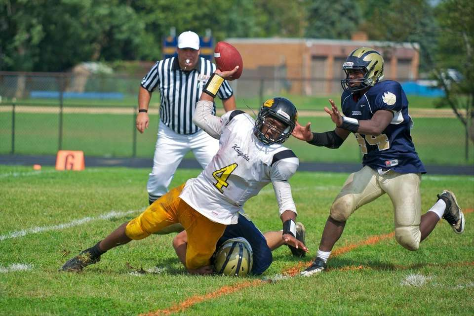 Uniondale quaterback Tyler Desire is sacked by Baldwin