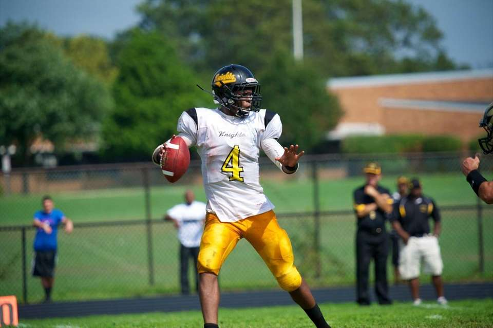 Uniondale quaterback Tyler Desire tries to avoid the