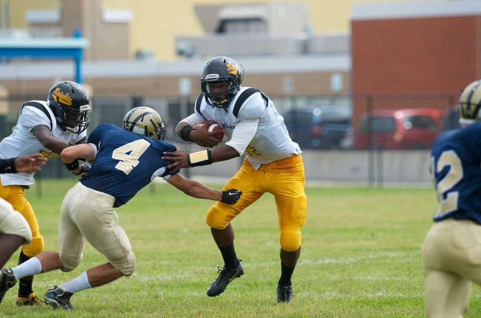 Uniondale quaterback Tyler Desire runs up field during