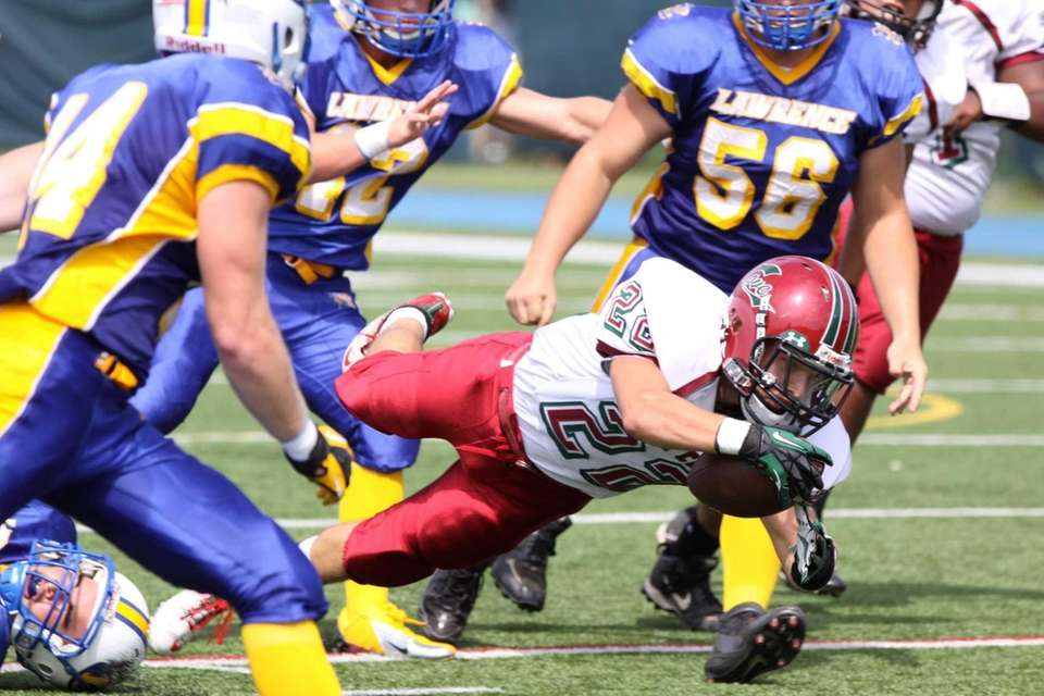 Glen Cove's Billy Neice gains yardage during their