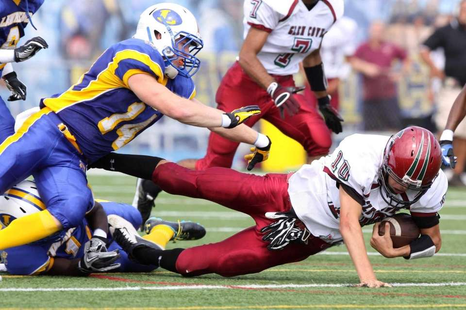 Glen Cove's Chris Klimaszewski, right, is tackled by