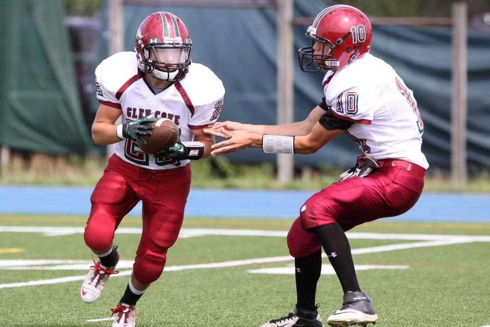 Glen Cove's Chris Klimaszewski, right, hands the ball