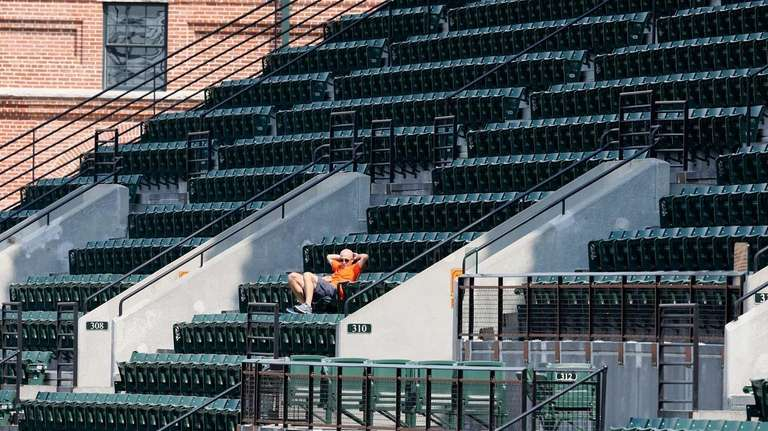 A lone fan watches the ninth inning of