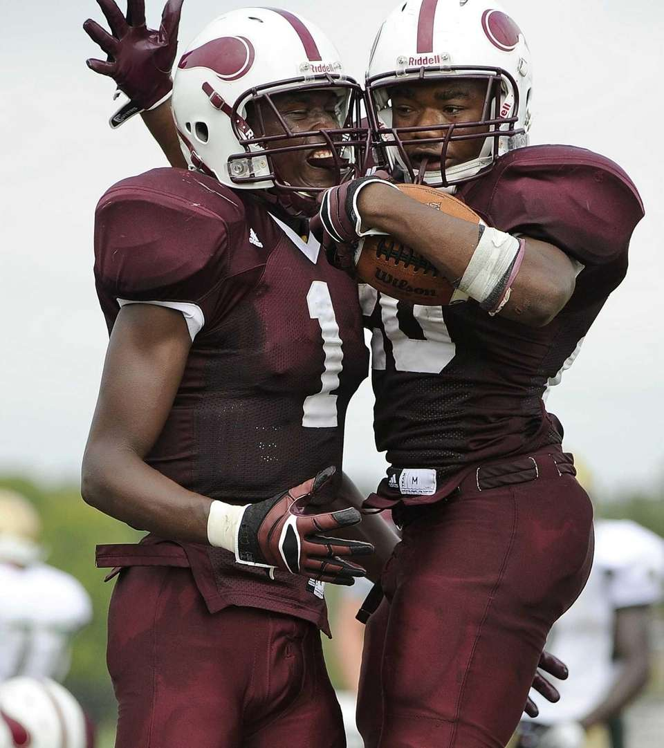 Bay Shore's Matthias Eato, right, celebrates his touchdown