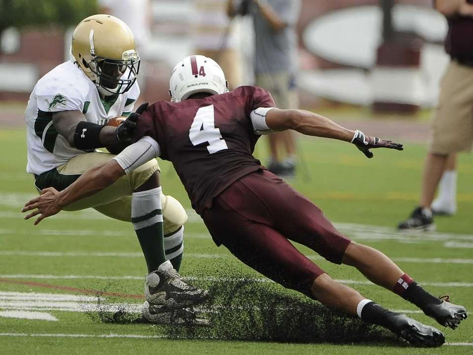 Bay Shore's Joel Nunez tackles Longwood's Isiah White.