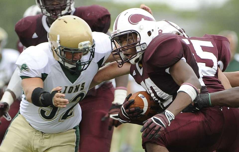 Bay Shore's Matthias Eato carries the ball against