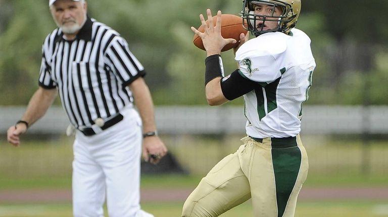 Longwood quarterback Kyle Corona looks to pass against